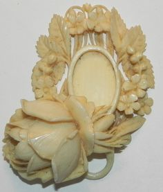 Antique Victorian Ivory Carved Picture Pendant. The picture area is protected by the carved flower bud and swings open on a small rivet