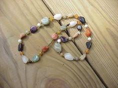 Multi gemstone necklace, polished stone