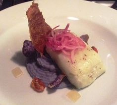 Baccalà agli agrumi su mousse di patata viola