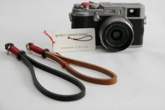Fuji x100 accessories: gordy leather wrist strap and red soft release shutter button