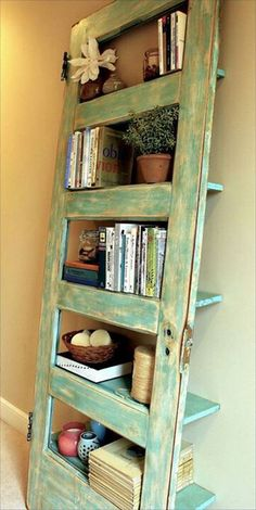 OMG we have an old door like this one .. I feel a project coming on :)   Old wooden door up cycled into a Bookcase--too cool!