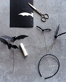 Stack and fold two sheets of black paper in half. Enlarge template. Position template on fold, trace, and cut out, making two bats. With black craft wire, poke a hole in the center of one bat; hold the end of the wire. Glue second bat on top, sandwiching wire in between. Wrap opposite end of the wire around a thin headband