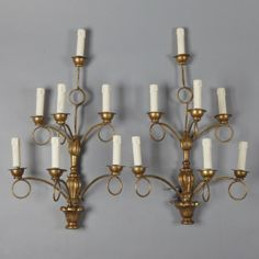 Pair of French Giltwood 7 Light Sconces --- This pair of French seven light sconces are made of gilt wood and iron and date from the early 20th century. These have been rewired for US electrical standards. ---  Item:  2263 --- Retail Price:  $1895