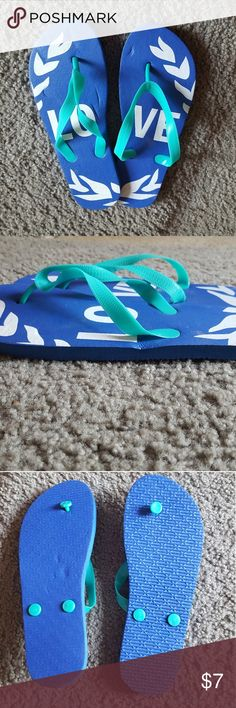 """NWOT Women's Flip-Flops Blue flip-flops with """"love"""" written across them. Size Small/5-6. Never worn-any markings are just from being in storage. Bundle & save 20%!🛍  I do my very best to describe my items as they are shown. I inspect each item before posting to sell. I encourage interested buyers to please ask any questions and to utilize the zoom on photos to inspect before buying.     Also on ➡️Ⓜ️ Shoes Sandals"""