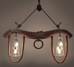 Ox Yoke Repurposed into One Of A Kind Chandelier very cool. I love using natural items and making them into a piece of art! What a statement this chandelier will make!