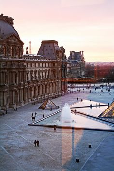 Paris Sunset from the Louvre window...  Entrance to Le Louvre Musee - Paris, France