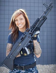 Girls with guns...and tattoos...