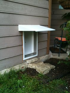 A great install of our electronic pet door with optional awning to help keep rain and snow out of your house!