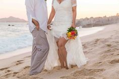 Beautiful focus on our bright, Mexican-themed #bridalbouquet...taking a walk down a lovely #Cabo beach! #destinationwedding #CaboFlowersandCakes #TheCaboFloralExpert www.loscabosflowers.com