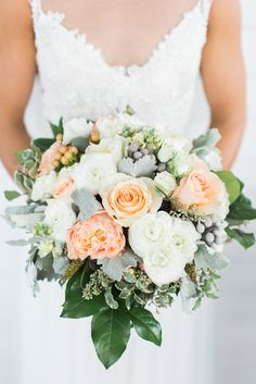 Peach, Ivory and Silver Bridal Bouquet | Through the Looking Glass | Keepsake Memories Photography https://www.theknot.com/marketplace/keepsake-memories-photography-jacksonville-nc-890314