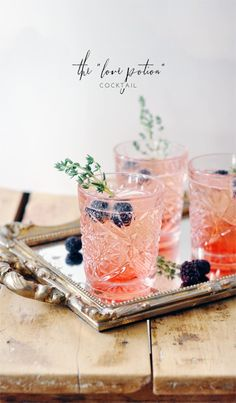 The Love Potion Cocktail (Serves 4)... Ingredients: BLACKBERRY SYRUP: 1/3c @ water+sugar+blackberries, COCKTAIL: 1 bottle prosecco or champagne, GARNISH: 4 sprigs of thyme 8 blackberries... Instructions: 1. In small saucepan, bring blackberries+water+sugar to a boil. Turn to low & let simmer 10min. Strain blackberries & let syrup cool. 2. Add 2Tbsp syrup to bottom of @glass. Top w/champagne+add a sprig of thyme+2 blackberries!  By Lark & Linen Adapted from The Effortless Chic