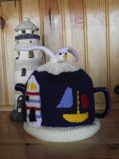 Items similar to pre order Nautical , lighthouse , sea , boat , seagull Theme Hand Knitted Tea Cozy / cosy on Etsy Finger Knitting, Hand Knitting, Baby Knitting Patterns, Scarf Patterns, Knitting Tutorials, Knitted Tea Cosies, Tea Cozy, My Tea, Nautical Theme