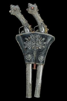 An ornate set of silver and coral mounted flintlock pistols with holster. Originates from Turkey, late 18th century.