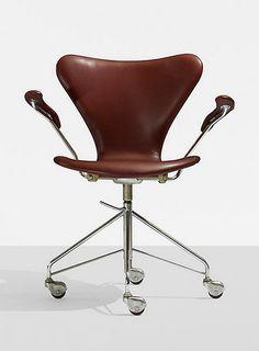 ARNE JACOBSEN, Sevener chair, model 3217 by Fritz Hansen, Denmark , 1955. Leather, matte chrome-plated steel and rubber.