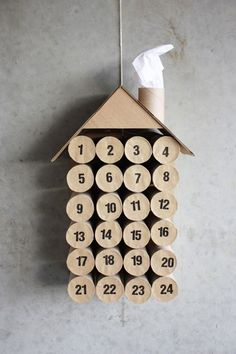 This house-shapped advent calendar will look so cute hanging on your wall, your guests will never guess it's made from repurposed toilet paper rolls.