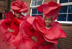 Suzanne Plunkett @suzanne_plunkett Young girls prepare to dance in a carnival parade at their primary school in London #visualsoflife #womeninphotography #inspiration #photo #photos #pic #pics #picture #photographer #pictures #snapshot #art #beautiful #photoshoot #photodaily #red #photography #girlgaze