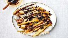 Parsnips bathed in warm olive oil and bejeweled with currents means you'll never look at root vegetables the same way again.