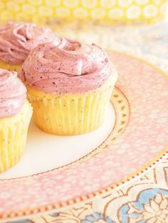 Blueberry Lemon Poppy Seed Cupcakes brushed with lemon syrup & frosted with creamy blueberry cream cheese frosting. They are out of this world!!! #cupcakerecipes