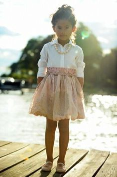 Childrens kids couture clothing style fashion: smart dressy outfit for girl. White collared shirt, pink satin skirt, pearl nevklace, pale pink shoes (mw)