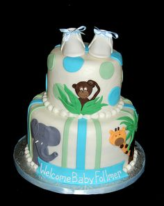 Elephant Monkey and Giraffe Jungle themed baby shower cake with baby shoes by Simply Sweets