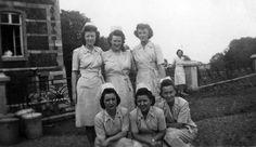 Army nurses in their seersucker dresses in front of the hospital in Liège, Belgium ~