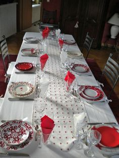 Happy table setting in reds and whites.