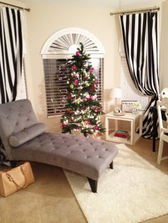 gray chaise with black and white curtains