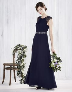 Our floor-grazing Bluebell maxi dress is crafted with a softly-gathered bodice with a round-cut neckline, and adorned with lace cap sleeves with scalloped edges. The insert binding on the waist accentuates the narrowest part of the silhouette, while the gently-flared skirt creates a feminine finish. Features a keyhole button detail, and a concealed zip fastening on the reverse. Fabric swatches for colour matching included. Model wears UK 8/UK S/EU 36/US 4. Model height is 175 cm/5'9.