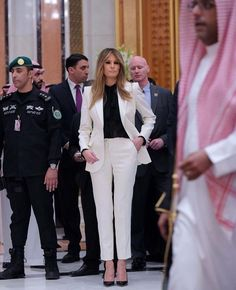 Melania in white pants and blazer by Dolce & Gabanna in Saudi Arabia on 5/20/17+
