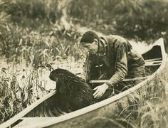 Beaver in a canoe with Grey Owl / Grey Owl dans son canot avec un castor | by BiblioArchives / LibraryArchives