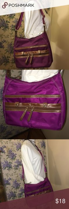 Nine West Purse EUC, adjustable strap! Nine West EUC, gorgeous purple color, tons of pockets. Three pockets on the outside +2 zipper pockets. On the inside there is one zipper pocket and two large pockets on the other side. This strap is adjustable so it can be a shoulder bag or cross body bag. The brown trim does not look like leather. There are silver metal hardware on it. It has cream colored stitching. Nine West Bags