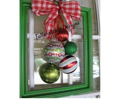 Want something a little different for your door or wall this Christmas? .....Christmas photo frame wreath with a variety of ornaments   This 10x13 frame wreath is a fun take on a traditional wreath. Looks great on the front door, a shelf, or a wall. ****NOTICE***Style of frame & ornaments may vary due to availability. Frame color can be chosen from the drop down menu. Ornaments will have the same color scheme as those pictured but will vary slightly from the ones in pic. Shape & design on…