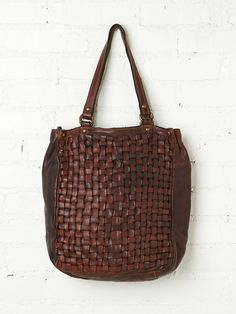 Woodsboro Woven Tote. Large distressed woven leather tote bag with zipper closure at top. Two leather handles. One inside pocket. Inside fully lined. Leather feels super supple and well worn to perfection. Back of bag has brand tag.