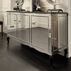 The sharp angles and mirrored sides of this table makes a big ...