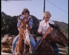 Bo and Luke Duke on horses.
