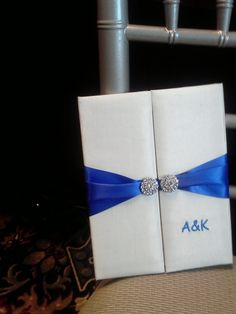 ELEGANT WEDDING Beautiful Satin Invitation Folios with Blue Satin Ribbon and Swarovski Circles and Embroidery & Invitation Mailing Box. CUSTOM DESIGNED by www.ECRDesigns.org  You can NOT get this exact design from ANYONE else! $33.00, via Etsy.