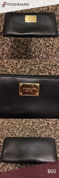 Michael Kors Wallet Love this all black wallet!! Love how many card compartments it has and it even has a change pocket!! Loved this wallet so much!! Barely any scratches and perfect condition!! Michael Kors Bags Wallets