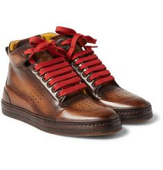 <a href='http://www.mrporter.com/mens/Designers/Berluti'>Berluti</a>'s 'Playtime' sneakers are nothing short of exquisite. Mirroring the sporty basketball shoe, this high-top style is crafted from smooth Venezia leather, that's known for its sleek, pollished appearance. The padded collars offer a comfortable fit, while perforated panels provide character and breathability. Swap to the spare red laces to try a different look.