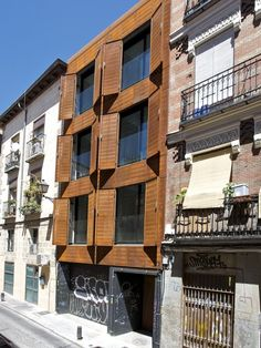 flush facade updates historical street \ San Vicente Ferrer | James & Mau | Madrid, Spain