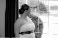 The Bride looks thoughtfully out the window before her life changes forever.