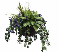 Handmade artificial pansy and greenery hanging basket available in various colors. This hanging basket is handmade and therefore can be customized to your taste