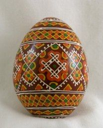 This wooden egg closely approximates a traditional Hutsul pysanka from Kosamch