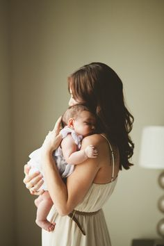 I love this photo - I would reflect a bit more light into the baby's face, but I'm definitely going to try something like this when I get to photograph a mom and newborn.