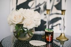 3 Ways To Arrange White Roses: Short & Full: This may be our favorite look! Using a round vase – arrange your roses tightly, trimming at the appropriate height. We find this tutorial helpful, which shows how you can use scotch tape as a grid to hold your flowers in place.