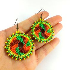 Hoop boho style beaded earrings. Yellow - orange - green - light green - brown.  Diameter: 3.7 cm (1.46 inches) Length including hooks:5.7 cm (2.25 inches)  I suggest you look at my other creations https://www.etsy.com/ru/shop/Galiga  Pattern designed by me. Please contact me if you would like to have different size or colors.  Please note that due to lighting effects, monitors brightness, contrast and other settings, there might be some slight differences in the color tone/shade of the web…