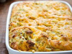 Cheesy Sausage Breakfast Casserole: This breakfast casserole of bread, sausage and cheese is bound with custard, almost like a savory bread pudding. It can be made the night before so you won't find yourself groggy and in need of caffeine, camped in front of a hot skillet. The next morning, remove it from the fridge to take the chill off. Grab a cup of coffee and pop it in the oven. By the time the table is set, the family is assembled and you're ready for your second cup, breakfast is ready!