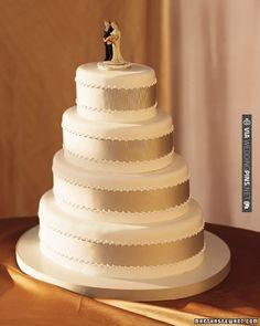 A band of grosgrain ribbon encircles each sleek, oval tier of this traditional wedding cake | VIA #WEDDINGPINS.NET