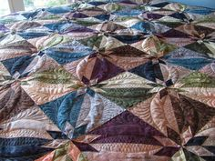 I've finished and given to Paula her Hunter Star Quilt. My Aunt had commissioned this quilt last July, and I finished it in June, so a ni...