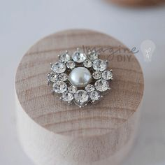 Small round decoration with pearl and crystals. DIY wedding stationery supplies. Pretty decoration for making wedding invitations.