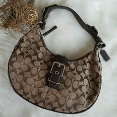 Authentic Coach Signature Jacquard Handbag Pre-owned but in fairly good condition. Elegant look. Leather edge trimmings & bottom has slight discoloration & scratches but hardly noticeable when worn. No visible damage One full size pocket at the back. Zipper & button closure. Coach Bags